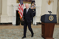United States President Joe Biden walks away from the podium after making remarks on the state of vaccinations in the State Dining Room of the White House in Washington, DC on Tuesday, April 6, 2021. Earlier, the President said he expects a significant portion of the population to be vaccinated by the end of the summer. <br /> CAP/MPI/RS<br /> ©RS/MPI/Capital Pictures