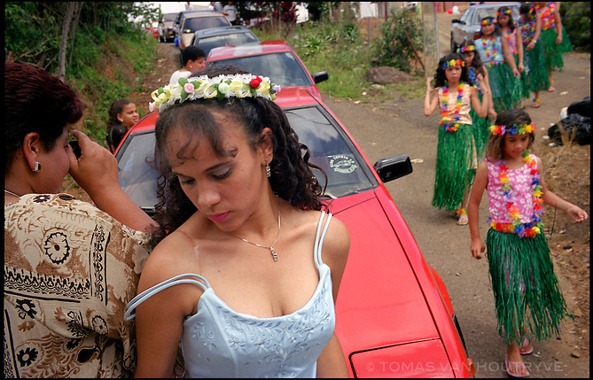 Johanis Santiago celebrates her quinceañera (15th birthday) near the town of Yauco, in the rural central mountain region of Puerto Rico, United States on 15 June, 2002. The quinceañera is an important celebration in most Hispanic and Iberian countries that marks the comming of age of teenage girls on their 15th birthday.<br />