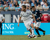 FOXBOROUGH, MA - JULY 27: Oriol Rosell #20 dribbles at midfield during a game between Orlando City SC and New England Revolution at Gillette Stadium on July 27, 2019 in Foxborough, Massachusetts.
