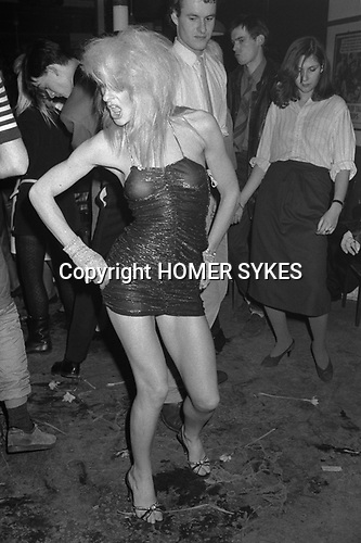 Covent Garden, London. 1980 <br /> Fashion student Wendy TigerPearson worked at Granny Takes a Trip in the Kings Road, Chelsea. She was also a dancer at the Embassy nightclub in Bond Street, seen here strutting her stuff at the Blitz Club.  Many years later Wendy can be found at a London university working in administration or on Saturday nights at the Chelsea Arts Club and still strutting her stuff.