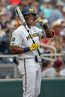 Michigan Wolverines designated hitter Jordan Nwogu (42) on deck during Game 1 of the NCAA College World Series against the Texas Tech Red Raiders on June 15, 2019 at TD Ameritrade Park in Omaha, Nebraska. Michigan defeated Texas Tech 5-3. (Andrew Woolley/Four Seam Images)
