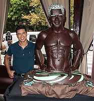 LOS ANGELES, CA - AUGUST 01: X-Factor/EXTRA's Mario Lopez unveils a life-size Dove Chocolate look-a-like sculpture at The Grove on August 1, 2013 in Los Angeles, California. (Photo by Xavier Collin/Celebrity Monitor)