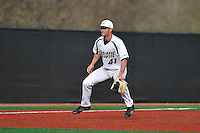 Third baseman Derek Gallelo (41) of the Charlotte 49ers hops into the air just before a pitch in a game against the Fairfield Stags on Saturday, March 12, 2016, at Hayes Stadium in Charlotte, North Carolina. (Tom Priddy/Four Seam Images)