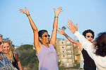 Mature mixed ethnic women in exercise class at Playa del Rey beach in Los Angeles, California