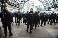 Anti fascists mobilise in Hamburg against a Nazi protest 12-9-15. Hamburg station is locked down by riot police as anti fascists attack nazis arriving for a banned far right protest. The police were deployed in very large numbers and nazis trying to arrive by train were confined to the station. There were few arrests.