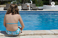 Girl relaxing by swimming pool, Jerba, Tunisia (Licence this image exclusively with Getty: http://www.gettyimages.com/detail/107813400 )