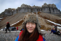 photograph by XAVIER CERVERA 06/2010.Endora Zhang, a broker and business woman from Beijing, China, in Skansenbukta, a stony beach with beautiful cliffs in Billfjorden, close to Longyearbyen capital, Spitsbergen island, Svalbard archipielago; in a afternoon landing to the beach from MS Fram, a norwegian vessel