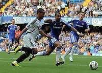 Pictured L-R: Wayne Routledge of Swansea against Ashley Cole of Chelsea. Saturday 17 September 2011<br />