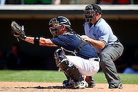Catcher Tyler Flowers #17 of the Charlotte Knights sets a target as home plate umpire Craig Barron looks on during an International League game against the Norfolk Tides at Knights Stadium July 5, 2010, in Fort Mill, South Carolina.  Photo by Brian Westerholt / Four Seam Images