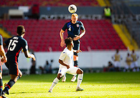 GUADALAJARA, MEXICO - MARCH 28: Justen Glad #4 of the United States heads a ball during a game between Honduras and USMNT U-23 at Estadio Jalisco on March 28, 2021 in Guadalajara, Mexico.