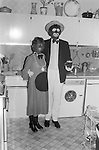 1980's British middle class society. Christmas Fancy Dress Party London. Couples dressed as the Black and White Minstrel's a popular on television of the time.