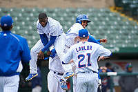 South Bend Cubs Delvin Zinn (3) and Christopher Morel (29) celebrate a walk-off victory after a Midwest League game against the Cedar Rapids Kernels at Four Winds Field on May 8, 2019 in South Bend, Indiana. South Bend defeated Cedar Rapids 2-1. (Zachary Lucy/Four Seam Images)