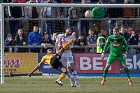 Souleymane Coulibaly of Newport County shoots at goal under pressure from Mike Edwards of Notts County during the Sky Bet League 2 match between Newport County and Notts County at Rodney Parade, Newport, Wales on 30 April 2016. Photo by Mark  Hawkins / PRiME Media Images.