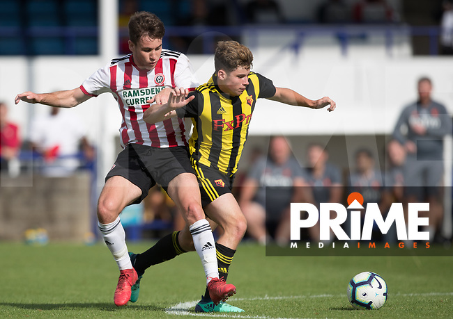 Ryan Cassisdy of Watford & George Cantrill of Sheffield United during the Professonal Development League match between Watford U23 and Sheffield United U23 at The Maurice Rebak Stadium, Summers Lane, England on 17 August 2018. Photo by Andy Rowland.