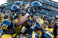 California head coach Jeff Tedford huddles together with the players before going back to the locker room before the game against Oregon State at AT&T Park in San Francisco, California on November 12th, 2011.   California defeated Oregon State, 23-6.