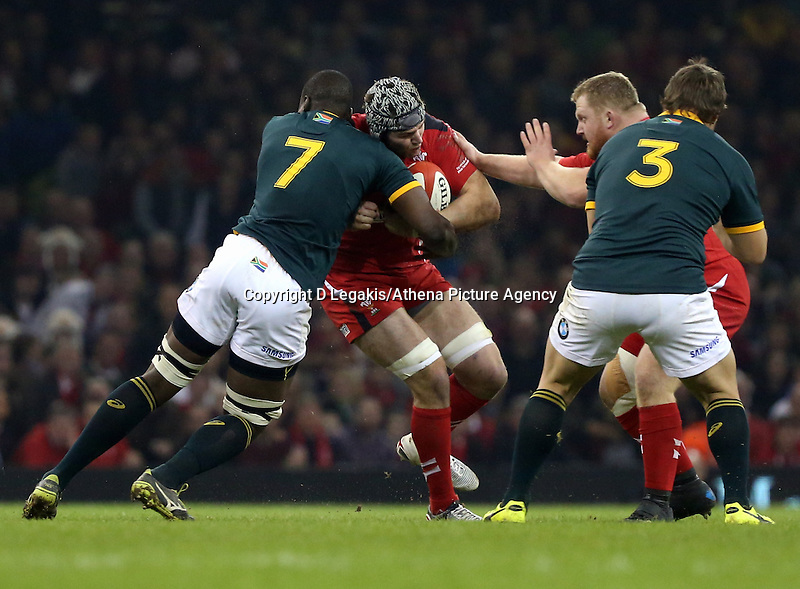 Pictured: Dan Lydiate of Wales (2nd L) is brought down by Teboho Mohoje (L) of South Africa Saturday 29 November 2014<br /> Re: Dove Men Series 2014 rugby, Wales v South Africa at the Millennium Stadium, Cardiff, south Wales, UK.