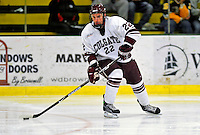 3 January 2009: Colgate Raiders' forward/defenseman Joe DeBello, a Senior from Oswego, IL, in action against the Ferris State Bulldogs during the consolation game of the 2009 Catamount Cup Ice Hockey Tournament hosted by the University of Vermont at Gutterson Fieldhouse in Burlington, Vermont. The two teams battled to a 3-3 draw, with the Bulldogs winning a post-game shootout 2-1, thus placing them third in the tournament...Mandatory Photo Credit: Ed Wolfstein Photo