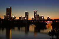 The early morning sun rises on the Austin Cityscape overlooking Lake Austin.