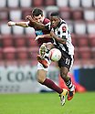 ST MIRREN'S NIGEL HASSELBAINK GETS TO THE BALL AHEAD OF HEARTS' RYAN MCGOWAN