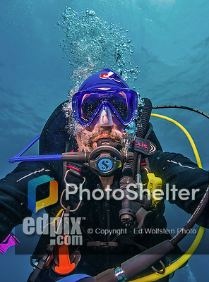"""11 June 2014: SCUBA Instructor and underwater photographer Ed Wolfstein takes a """"selfie"""" self-portrait to verify the operation of his camera and strobe rig, while exploring the reef scenery at Lemon Reef, on the North Shore of Grand Cayman Island. Located in the British West Indies in the Caribbean, the Cayman Islands are renowned for excellent scuba diving, snorkeling, beaches and banking.  Mandatory Credit: Ed Wolfstein Photo *** RAW (NEF) Image File Available ***"""