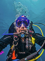 "11 June 2014: SCUBA Instructor and underwater photographer Ed Wolfstein takes a ""selfie"" self-portrait to verify the operation of his camera and strobe rig, while exploring the reef scenery at Lemon Reef, on the North Shore of Grand Cayman Island. Located in the British West Indies in the Caribbean, the Cayman Islands are renowned for excellent scuba diving, snorkeling, beaches and banking.  Mandatory Credit: Ed Wolfstein Photo *** RAW (NEF) Image File Available ***"