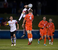 Jack Metcalf (4) of Clemson goes up for a header with Patrick Mullins (15) of Maryland during the game at the Maryland SoccerPlex in Germantown, MD. Maryland defeated Clemson, 1-0, in overtime.  With the win the Terrapins advanced to the finals of the ACC men's soccer tournament.