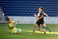 FC Gold Pride midfielder Christine Sinclair (12) beats Red Stars goalkeeper Jillian Loyden (1).  The FC Gold Pride defeated the Chicago Red Stars 3-2 at Toyota Park in Bridgeview, IL on August 22, 2010