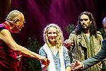 © Joel Goodman - 07973 332324 . 16/06/2012 . Manchester , UK .  KILA CURRAN COLEMAN (centre) , 13 , from County Limerick in the Republic of Ireland receives an award for forgiveness from the DALAI LAMA (left) as RUSSELL BRAND (right) looks on . Kia's father Pat Coleman was murdered in Limerick six years ago in an unprovoked attack and she wrote a letter of forgiveness to her father's killer . Stand Up and Be the Change youth event , hosted by the Dalai Lama during a 10 day UK tour , at the Manchester Arena . Photo credit : Joel Goodman