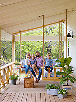 Josh McCullock and family on the swinging L-shaped porch bed.