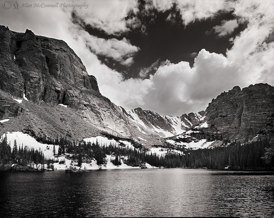 """""""The Loch""""<br /> Rocky Mountain National Park, Colorado<br />  2011<br /> <br /> Cradled within the Glacial Gorge Basin, the Loch lures hikers along the 2.7 mile Vale Trailhead in Rocky Mountain National Park.  Climbing to an elevation of 10,180 feet, the trail offers breathtaking scenery of Glacier Creek, North Longs Peak, Mills Lake-Black Lake and Lake Haiyaha.  Numerous spurs with gorgeous views of the steep rock walls surrounding the lake lead to the water's edge where ideal picnic opportunities exist. <br /> <br /> 4 x 5 Large Format Film"""