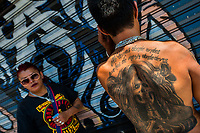 A Mexican believer shows his Santa Muerte (Holy Death) tattoo during a religious ceremony in Tepito, a dangerous neighborhood of Mexico City, Mexico, 1 April 2018. The religious cult of Santa Muerte is a fusion of Aztec death worship rituals and Catholic beliefs. Born in lower-class neighborhoods of Mexico City, it has always been closely associated with crime. In the past decades, original Santa Muerte followers, such as prostitutes, pickpockets and street drug traffickers, have merged with thousands of ordinary Mexican Catholics. The Holy Death veneration, offering a spiritual way out of hardship in modern society, rapidly expanded. Although the Catholic Church still considers Santa Muerte followers the devil worshippers, on the first day of every month, crowds of Santa Muerte believers fill the streets of Tepito. Holding statues of Holy Death clothed in a long robe, they pray for healing, protection, money or any other favor in life.