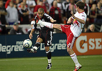 Fred (27) of D.C. United sends a cross past Teemu Tainio (2) of the New York Red Bulls during an MLS match at RFK Stadium, in Washington D.C. on April 21 2011. Red Bulls won 4-0.