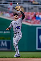 15 April 2018: Colorado Rockies shortstop Trevor Story pulls in an infield fly ball during game action against the Washington Nationals at Nationals Park in Washington, DC. All MLB players wore Number 42 to commemorate the life of Jackie Robinson and to celebrate Black Heritage Day in pro baseball. The Rockies edged out the Nationals 6-5 to take the final game of their 4-game series. Mandatory Credit: Ed Wolfstein Photo *** RAW (NEF) Image File Available ***