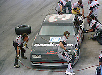 NASCAR driver Dale Earnhardt makes a pit stop in the #3 Goodwrench Chevrolet during the Pepsi Firecracker 400 at Daytona International Speedway in Daytona Beach, FL on July 2, 1988.  Earnhardt finished fourth in the race.  (Photo by Brian Cleary/bcpix.com)