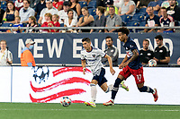 FOXBOROUGH, MA - AUGUST 18: Tajon Buchanan #17 of New England Revolution dribbles down the wing as Joseph Mora #28 of D.C. United defends during a game between D.C. United and New England Revolution at Gillette Stadium on August 18, 2021 in Foxborough, Massachusetts.