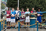 From Left to Right: West Ham United's Moses Makasi, Glasgow Rangers' Max Ambrose, Causeway Bay's Andrew Wylde, Aston Villa's Harry McKirdy, Olympique Marseille's Lucas Genty, Cagliari Calcio's Vasco Oliveira, and Leicester City's Hamza Dewan Choudhury pose for a photograph near the Noon Day Gun to celebrate the launch of the HKFC Citi Soccer Sevens 2017 on 25 May 2017 in Causeway Bay, Hong Kong, China. Photo by Chris Wong / Power Sport Images
