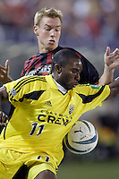The Crew's Jeff Cunningham who scored the only goal of the first half, battles the MetroStars' Chris Leitch for the ball during first half action between the Columbus Crew and the MetroStars in a regular season MLS game on Saturday October 9, 2004 at Giant's Stadium, East Rutherford, NJ..
