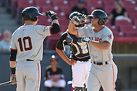 Hunter Cole (2) of the San Jose Giants is greeted by teammate Austin Slater (10) after hitting a home run during a game against the High Desert Mavericks at Mavericks Stadium on June 14, 2015 in Adelanto, California. High Desert defeated San Jose, 7-5. (Larry Goren/Four Seam Images)