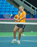 Moskou, Russia, Februari 4, 2016,  Fed Cup Russia-Netherlands,  Dutch team practise doubles Cindy Burger and Richel Hogenkamp (R)<br /> Photo: Tennisimages/Henk Koster