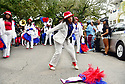 Ja'Lissia Washington dances at the Ladies of Unity Secondline, uptown, 2018