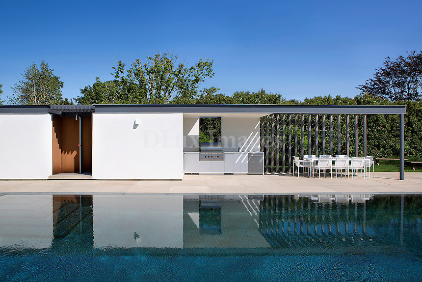 luxury swimming pool<br /> <br /> Modern and luxurious weekend and summer home in Sagaponack in the Hamptons, New York.  The 10,000 sq. ft. residence was designed by architect and interior designer, Francis D'Haene of D'Apostrophe.