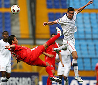 Sebastian Lletget (right) collides with Panama player. USA Men's Under 20 defeated Panama 2-0 at Estadio Mateo Flores in Guatemala City, Guatemala on April 2nd, 2011.