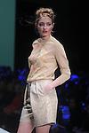 A model walks the runway during Roland Santana show at Fashion Houston at the Wortham Theater Thursday Nov.14,2013.  (Dave Rossman photo)