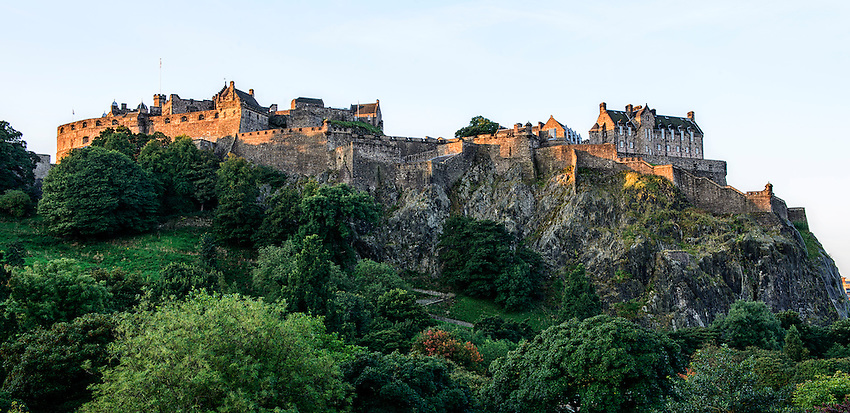 Edinburgh Castle as seen from Princes Street, Edinburgh, in early morning light just after sunrise.