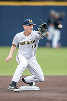 Michigan Wolverines second baseman Jimmy Kerr (15) warms up before the Big Ten baseball game against the Maryland Terrapins on April 13, 2018 at Ray Fisher Stadium in Ann Arbor, Michigan. Michigan defeated Maryland 10-4. (Andrew Woolley/Four Seam Images)