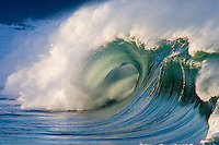 Beautiful wave at the shore break of Waimea Bay on the North Shore of Oahu, Hawaii.  Waves break here during the winter months.
