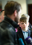 Young Callum Burke looks on as his uncle John Burke is interviewed by the media on his arrival back to Shannon Airport, following his successful attempt, being the first Clare person ever to climb Mount Everest. Photograph by John Kelly.