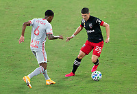 WASHINGTON, DC - SEPTEMBER 12: Kyle Duncan #6 of the New York Red Bulls defends Joseph Mora #28 of D.C. United during a game between New York Red Bulls and D.C. United at Audi Field on September 12, 2020 in Washington, DC.