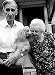Family Portrait--Harold and Sally Canham, married for 46 years, pose for a portrait with their poodle Angel outside their eastside Springfield, Illinois home.