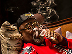 George Clinton - 77 year old American songwriter, band leader, and record producer who launched the band Parliament - Funkadelic and heavily influenced popular music over five decades - smokes marijuana on the couch at his home in Tallahassee, Florida. Clinton was inducted into the Rock and Roll Hall of Fame in 1997 and is set to retire in early 2019.